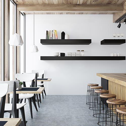 White bar interior with a concrete floor, a wooden bar and rows of stools near it. Square black and white tables and chairs and a poster on the wall. 3d rendering mock up